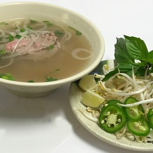Pho Tai. Eye-round steak with Vietnamese noodle soup stock simmered for hours and pho noodles